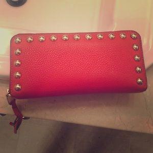 Rebecca Minkoff zip wallet orange gold studs